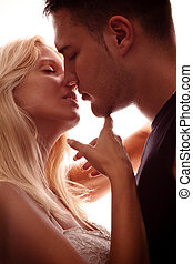 lovers - young couple in love, kissing, studio shot, back...