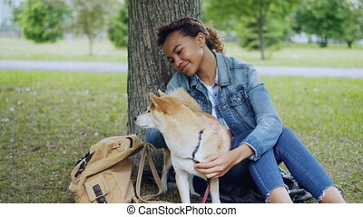 Loving African American girl student is stroking lovable...