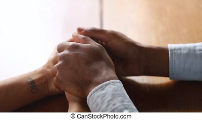 Loving african husband holding hands of wife give support,...
