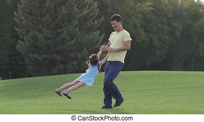 Loving asian dad playing with his lovely daughter - Joyful...