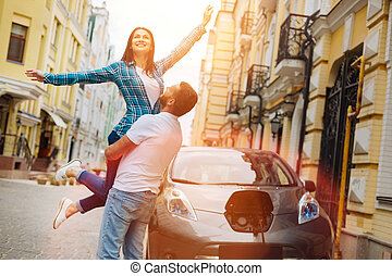Loving boyfriend lifting up his beautiful girlfriend