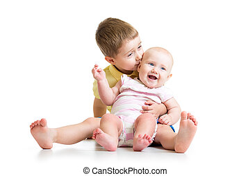 Loving brother kissing baby sister isolated on white