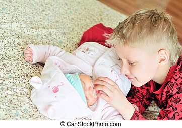 loving brother with newborn sister