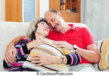 Loving casual senior couple