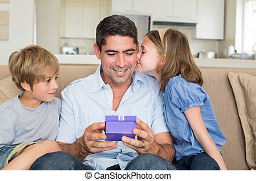 Loving children gifting father