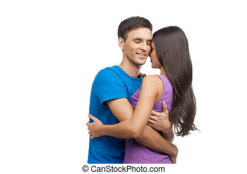 Loving couple. Beautiful loving couple hugging while standing isolated on white