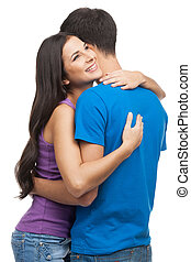 Loving couple. Beautiful young loving couple hugging while standing isolated on white