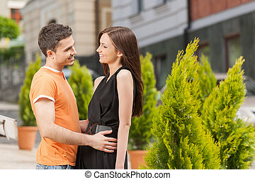 Loving couple. Beautiful young loving couple hugging and looking at each other