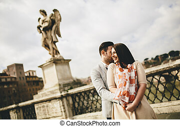 Loving couple by the Castel Sant'Angelo in Rome, Italy