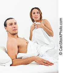 Loving couple caught in bed