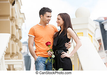 Loving couple. Cheerful young couple hugging while looking at each other
