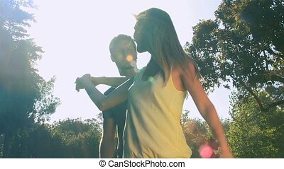 Loving couple dancing and hugging in a beautiful park