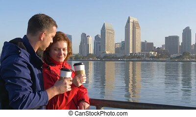 Loving couple drinking coffee in San Diego - Loving couple...