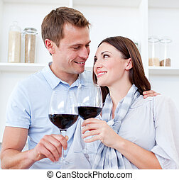Loving couple drinking red wine