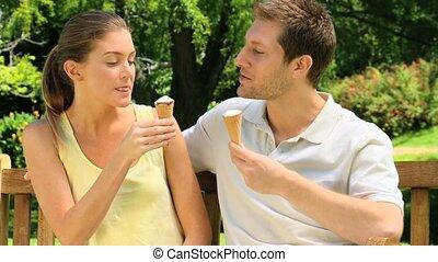 Loving couple enjoying ice cream