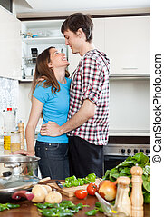 loving couple flirting  in  kitchen