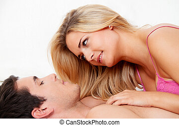 loving couple having fun in bed