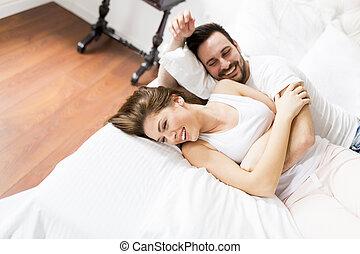Loving couple having fun in bed