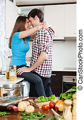 loving couple having sex at table in  kitchen