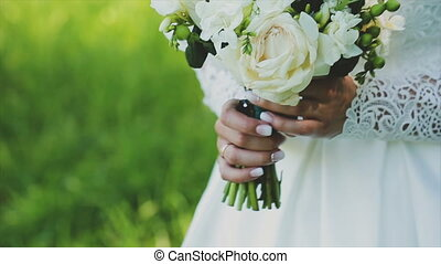 Loving couple holding a wedding bouquet in hands