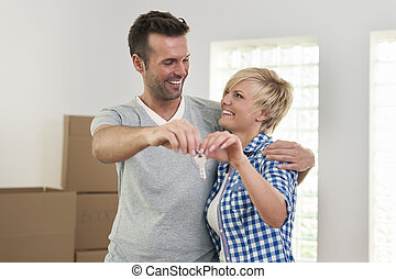 Loving couple holding key to new home