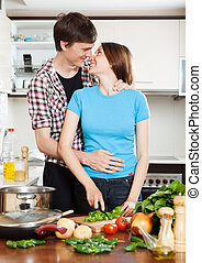 loving couple hugging in  kitchen