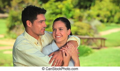 Loving couple hugging outdoors
