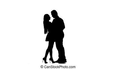 Loving couple hugs. White background. Silhouette. Slow motion