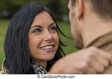 loving couple in a park - a young, laughed liebtes couple in...