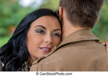 loving couple in a park - a young, verl liebtes couple in a...