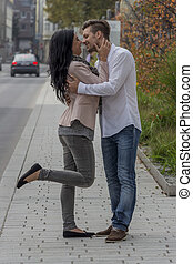 loving couple in an urban setting - a couple having fun in a...