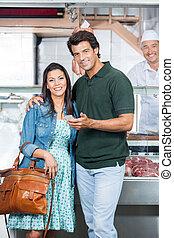 Loving Couple In Butchery