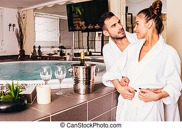 Loving couple in spa center
