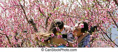 loving couple in spring garden