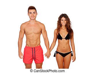 Loving couple in swimwear isolated on white background