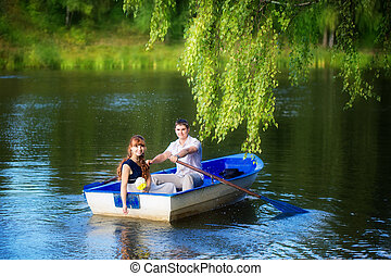 Loving couple in the boat. Summer vacation concept.