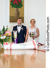 Loving couple in the registry office - Man and woman in a...