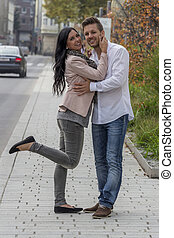 loving couple in urban environment - a loving couple have...
