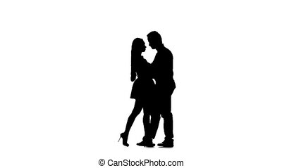 Loving couple is dancing Latin dances in the studio. Silhouette. White background. Slow motion