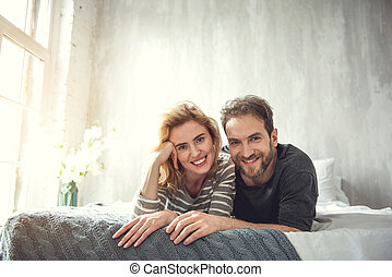 Loving couple is relaxing in bedroom