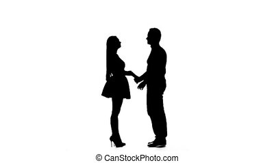 Loving couple kisses and dances together. Silhouette. White...