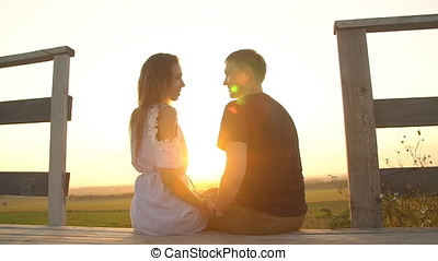 Loving couple kissing at sunset. - Loving couple kissing at...