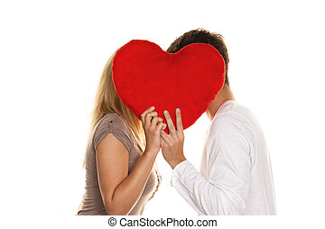 Loving couple kissing behind a heart. Love is Sho - Loving...
