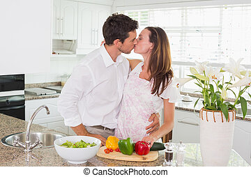 Loving couple kissing in the kitchen