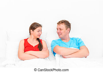 loving couple looking at each other in bed
