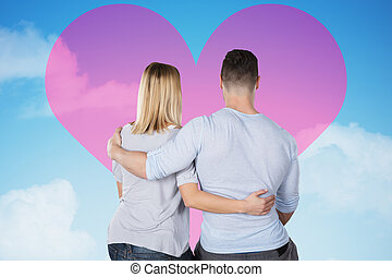 Loving Couple Looking At Heart On Sky