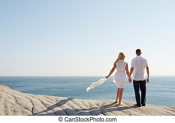 Loving couple looking at the sea