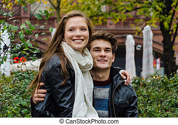 Loving Couple Looking Away In Park