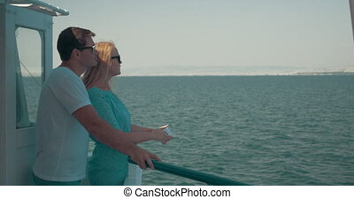 Loving couple making mobile selfie during sea tour