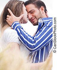 Loving couple, Man looking at camera